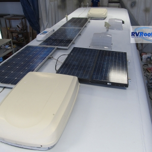 Coach-roof-with-solar-panels-installed-after-FlexArmor-roof-application