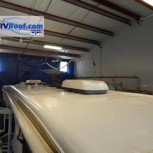 Fifth wheel with satellite dish sprayed rv roof